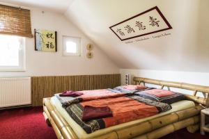 En eller flere senge i et værelse på Casa Casimir