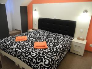 A bed or beds in a room at Apartments Verona Karlovy Vary