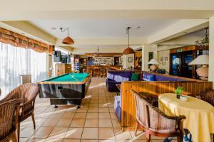 A pool table at Estella Hotel Apartments