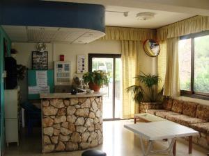 The lobby or reception area at Aphelandra Hotel Apartments