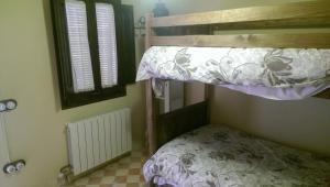 Litera o literas de una habitación en Cal Magret