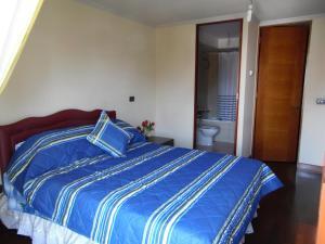 Cama o camas de una habitación en Kuizi departamento Manuel Montt