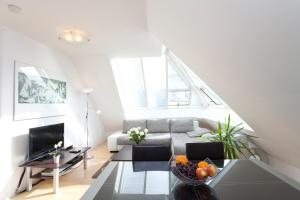 A television and/or entertainment center at Vienna-apartment-one Mariannengasse