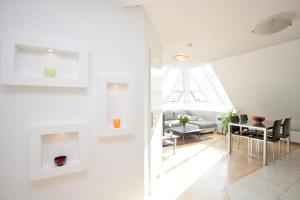 A seating area at Vienna-apartment-one Mariannengasse