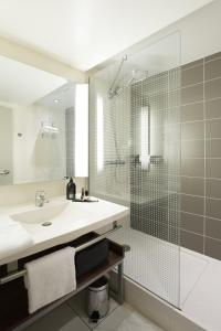 Ванная комната в Aparthotel Adagio Toulouse Centre Ramblas