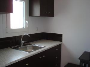 A kitchen or kitchenette at Elena Studios & Suites