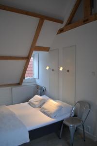 Een bed of bedden in een kamer bij Zeezout