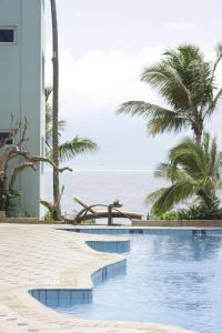 The swimming pool at or near Cowrie Shell Beach Apartments