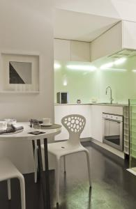A kitchen or kitchenette at Suitime