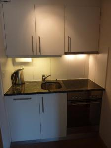 Küche/Küchenzeile in der Unterkunft Chalet Aebnetbode