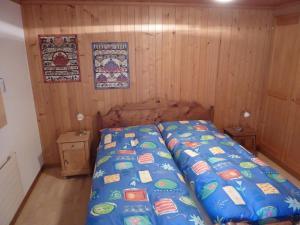 Ein Bett oder Betten in einem Zimmer der Unterkunft Chalet Aebnetbode