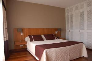 A bed or beds in a room at La Residence Du Rova