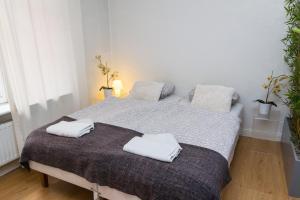 Łóżko lub łóżka w pokoju w obiekcie Modern Apartments