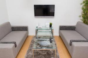 Część wypoczynkowa w obiekcie Modern Apartments