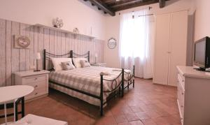 A bed or beds in a room at Maison della Scala