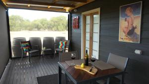 A restaurant or other place to eat at Windfall Estate Vineyard Cottage