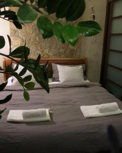 Ein Bett oder Betten in einem Zimmer der Unterkunft HIP Home Panorama Apartment