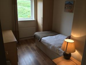 A bed or beds in a room at Doolin Village Lodges