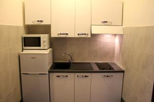 A kitchen or kitchenette at Holiday Homes