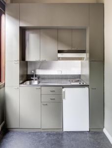 Kuchyň nebo kuchyňský kout v ubytování Regents Court Sydney