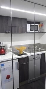 Cuisine ou kitchenette dans l'établissement Nice Appart
