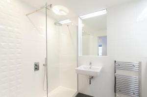 A bathroom at Destiny Scotland -The Malt House Apartments