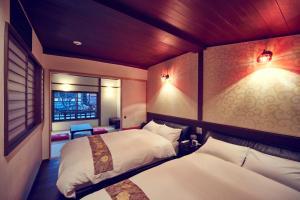 Cama o camas de una habitación en Hana-Touro Stay Yasakano-Tou Machiya Premium