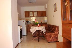 A kitchen or kitchenette at Fantasy Apartments
