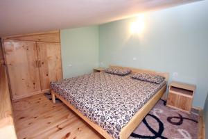 Giường trong phòng chung tại Apartment Djordjije