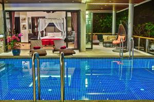 The swimming pool at or near Grand Villa Luxury Time Phuket