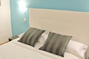 Кровать или кровати в номере Estudio Paraiso del Sur