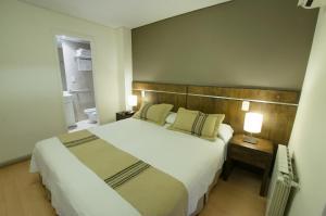 Una cama o camas en una habitación de Quinta & Suites Apart Hotel