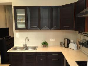 Küche/Küchenzeile in der Unterkunft Central King Apartment