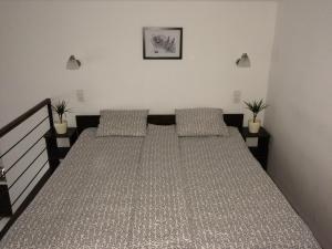 Ein Bett oder Betten in einem Zimmer der Unterkunft Central King Apartment
