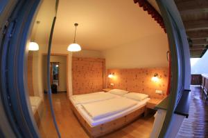 A bed or beds in a room at Appartement-Edelweiss