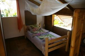 Un ou plusieurs lits dans un hébergement de l'établissement TiCoco Détente, Spa et Jardin Privés