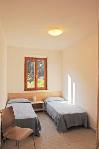 A bed or beds in a room at Appartamenti Casa Pineta