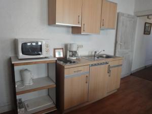 A kitchen or kitchenette at Le Studio de Christine