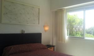 Una cama o camas en una habitación de Departamentos Alhambra