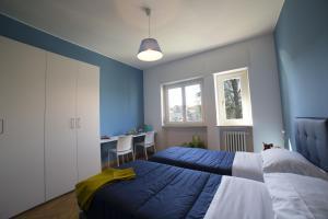 מיטה או מיטות בחדר ב-Dreams Hotel Residenza Gambara
