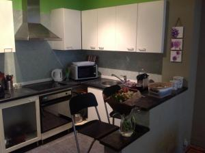 A kitchen or kitchenette at Appart Métropole Brussels