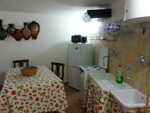 Cucina o angolo cottura di Il Dammuso dell'Orologio