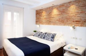 Ein Bett oder Betten in einem Zimmer der Unterkunft Feelathome Center Apartments