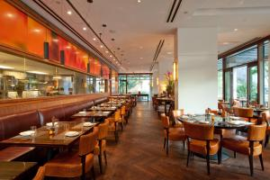 A restaurant or other place to eat at Trump Waikiki by Gaia Resort