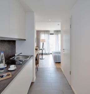 Een keuken of kitchenette bij Hotel M120