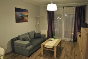 A seating area at Lawendowy Apartment