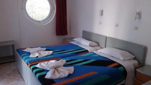 Letto o letti in una camera di Manine Apartments