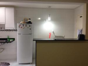 A kitchen or kitchenette at Apartamento em Aracaju - Sergipe