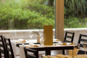 Ein Restaurant oder anderes Speiselokal in der Unterkunft Apartments Punta