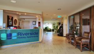 The lobby or reception area at Riverside Holiday Apartments